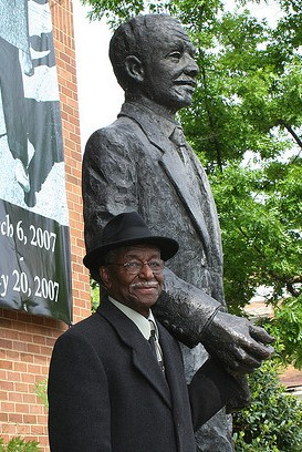 Rev. Fred Shuttlesworth beside his statue in front of the Birmingham Civil Rights Institute (Wayne Taylor / Creative Commons)