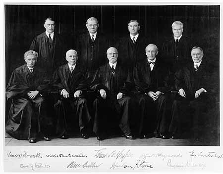 Front row: Justices Brandeis and Van Devanter, Chief Justice Hughes, and Justices McReynolds and Sutherland. Back row: Justices Roberts, Butler, Stone, and Cardozo.